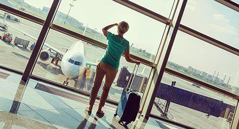 a lady awaiting a flight