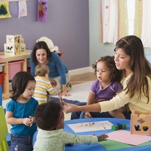 childcare staff with children
