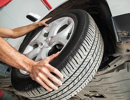 Professional installing a new tyre