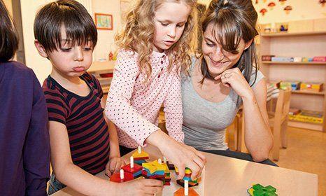 children playing with teacher