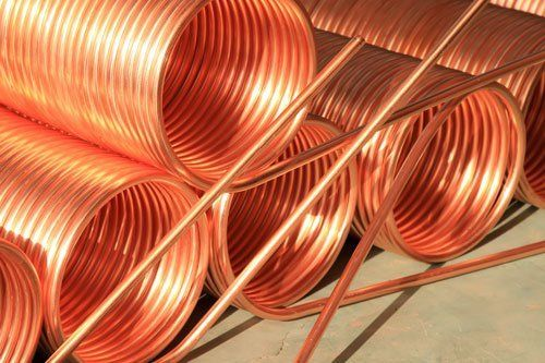Stacked copper spiral parts in Rochester