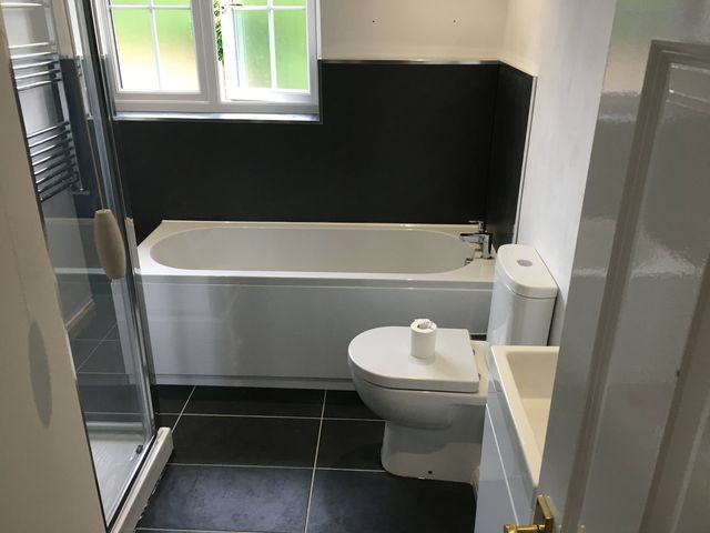 installation of wet board with chrome trim for bath surround and shower enclosure