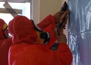 experts removing asbestos