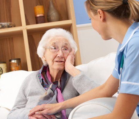 nurse tending to old lady's care
