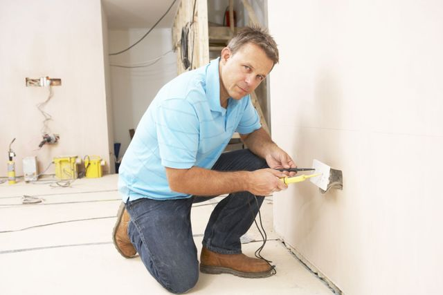 qualified electrician at work