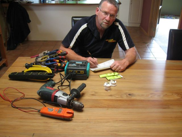 Man with electrical power tools