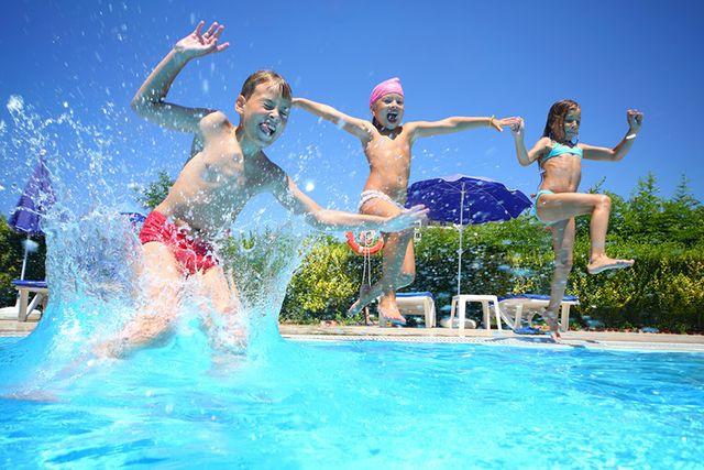 Kids playing happily in serviced swimming pool