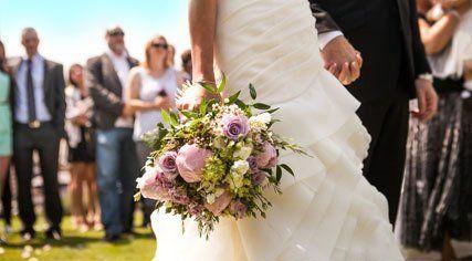 A bride holding a pretty bouquet
