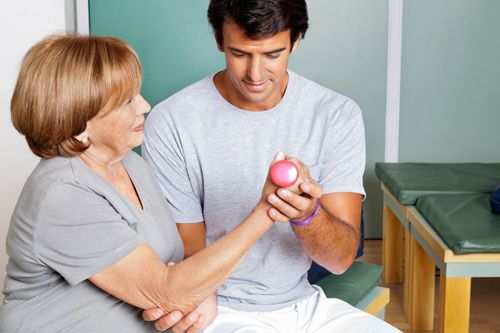 Professional providing occupational therapy services to a patient in Mountain Home, AR