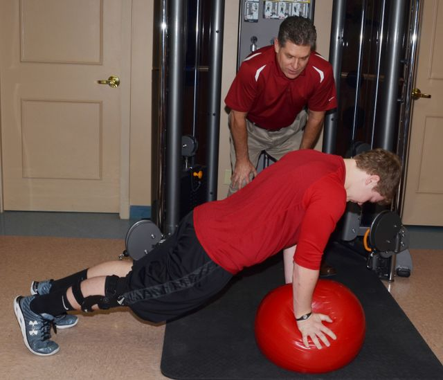 Physical therapist oversees patient exercise