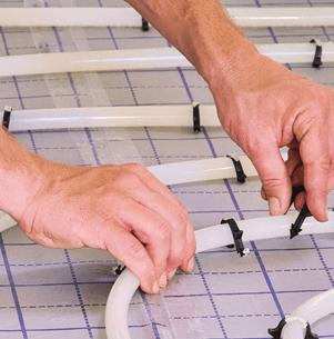engineer fitting underfloor heating pipework