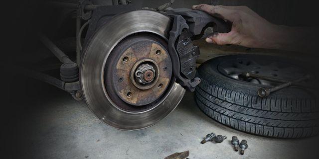 A mechanic holding a brake disc