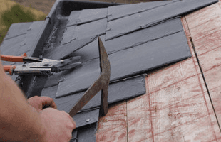 Roof tiles being replaced on a roof