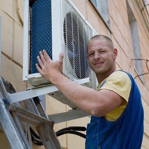Expert installing air conditioner