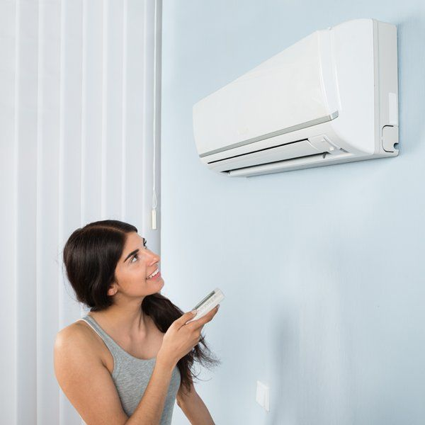 woman controlling the temperature