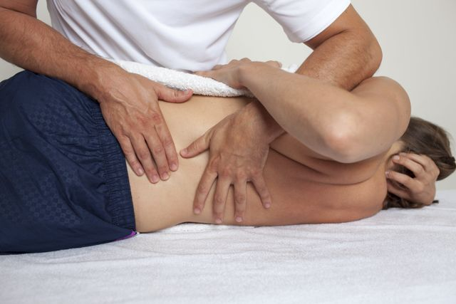 pregnancy woman massage therapist relaxation