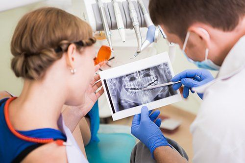 Doctor examining the x-ray report of gums
