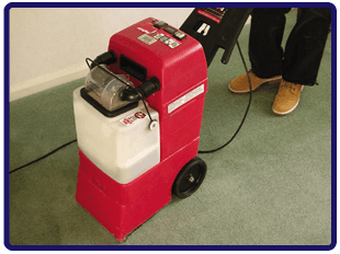 Red carpet cleaning machine, cleaning a green carpet