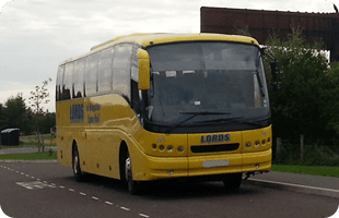 Yellow coach on the road