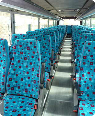interior of a coach with blue and red seating