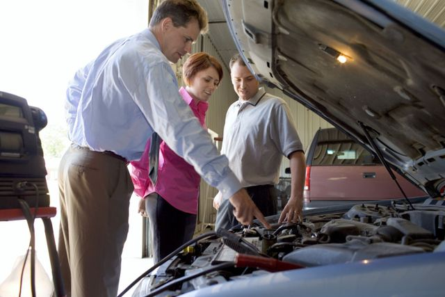A mechanic explaining to a client what needs to be done to the car