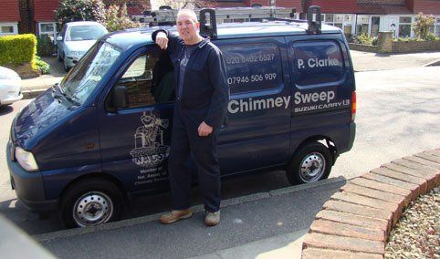 Paul Clarke standing beside a company vehicle