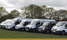 several vans parked