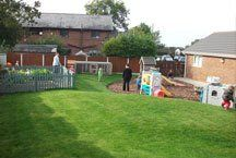 The safe outdoor area with play equipment