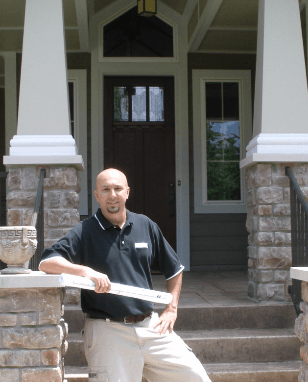 Scott in-front of a custom home build in St. Louis, MO