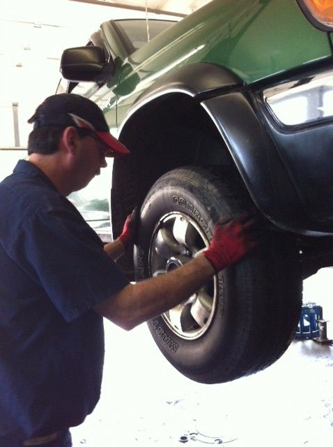 One of our experts changing a tire
