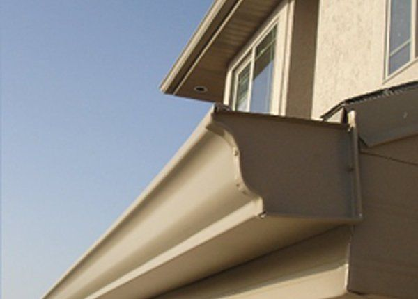 Residential gutter under roof