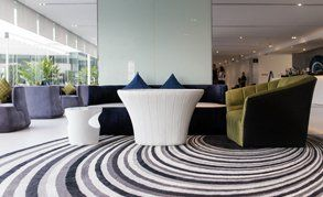 A carpet in a reception area with a swirling design on it