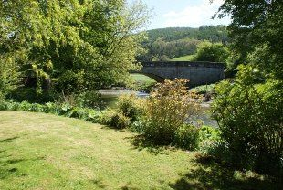 Looking from the lawn to the bridge over the River Tanat