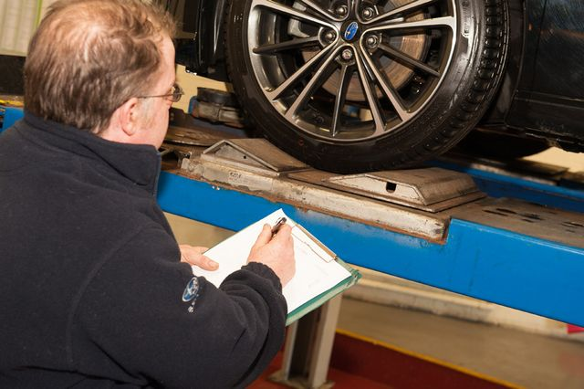 Car specialist checking tyres in Peterborough