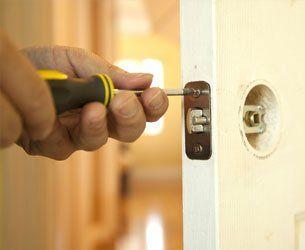 man fixing lock to the door
