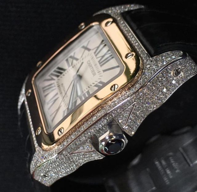 customised diamond set cartier watch