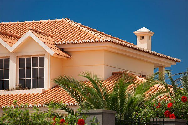 Orange tiled roof on big house maintained by experts in Hauula