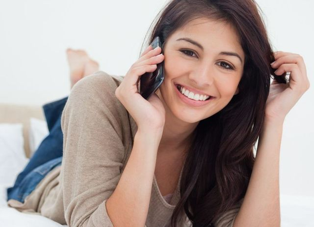 Woman calling for professional massage therapy in Aiea, HI