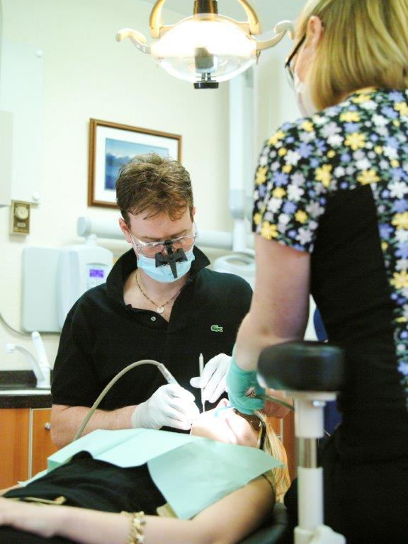 Dentist with teeth care equipment at premier general dentistry clinic in Juneau, AK
