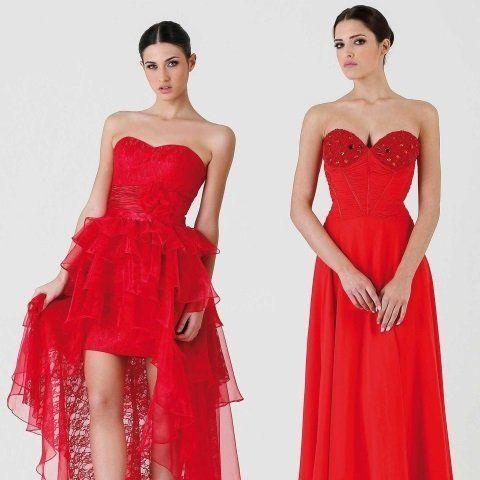 due donne con degli abiti di color rosso