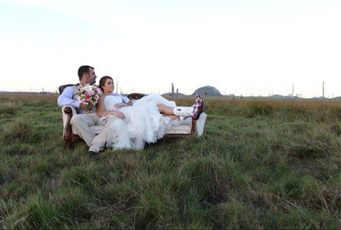 man and wife sitting on a sofa in the farm