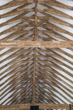 The interior wooden structure of house roofing