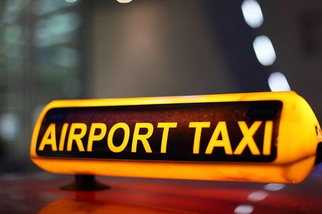 Airport taxi sign illuminated at night