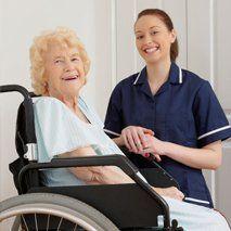 an elderly woman on a wheelchair