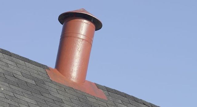Chimney flue atop a Rodney home after heating installation