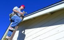 Our team carrying out roof repair services in Anchorage, AK