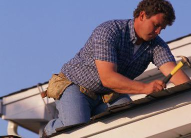 One of our roofing professionals at work in Anchorage, AK