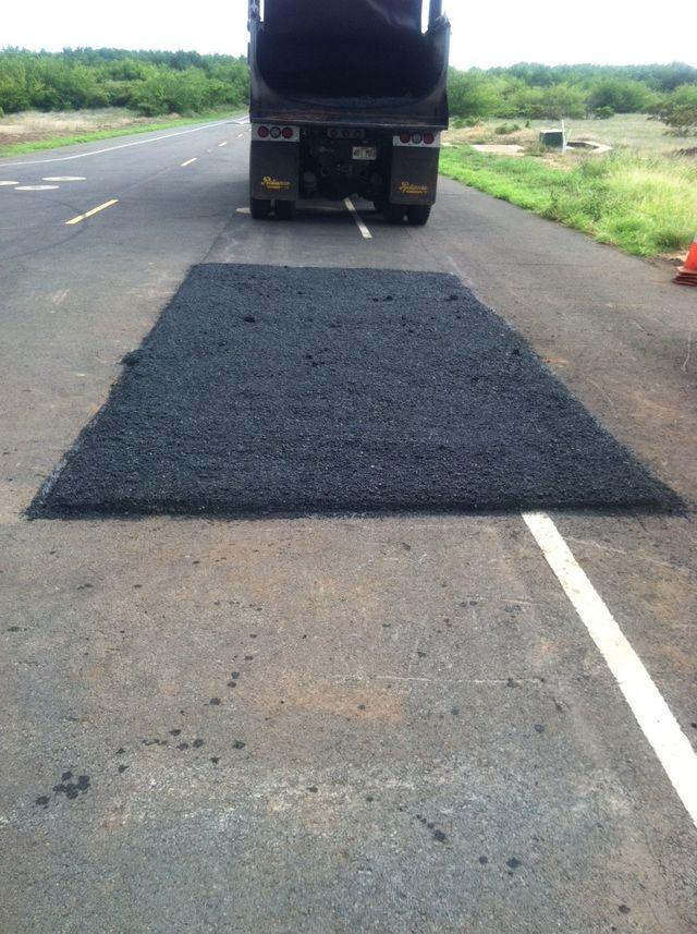A road that needs asphalt repair