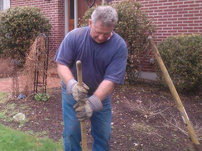 Septic and sewer expert digging in ground