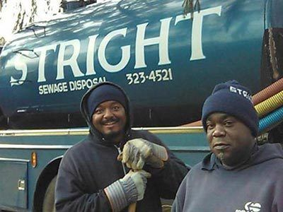 Two septic and sewer workers posing in Stamford